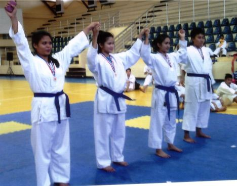 Sheila Mae Nicolas(left) of DWCU won gold medal in Kumite - 68 category