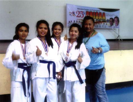 (l-r) Annabelle Ventura - Silver Medalist (KATA); Shiela Mae Ventura - Gold Medalist (Kumite); Jerlyn Ganube - Bronze Medalist (Kata); Jing-jing Paasa - Silver Medalist (Kumite)and Bronze Medalist (Kata) ; Mrs. Corazon O. Bustria (Coach)