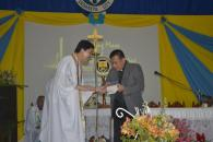 Fr. Edwin handed to Fr. Robert the Bible as the source of inspiration and spiritual nourishment