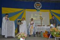 The presentation of the toga, hood and robe, as symbols of academic excellence and authority