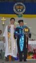 Fr. Edwin Fernadez, SVD and Fr. Roberto J. Ibay, SVD, holding the DWCU Mace and flag