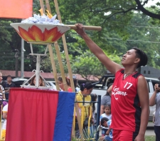 Lighting of the Torch and Urn by Brian Aviles, a student from the Lyceum Northern Luzon.